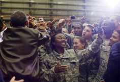 President Obama is seen greeting soldiers at Bagram Airfield after an unannounced and all-night flight to Afghanistan.