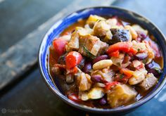 BEST vegetarian chili EVER! With eggplant, plum tomatoes, onion, garlic, zucchini, bell peppers, jalapeños, white beans, kidney beans, and cilantro. #vegan #spicy #easy On SimplyRecipes.com