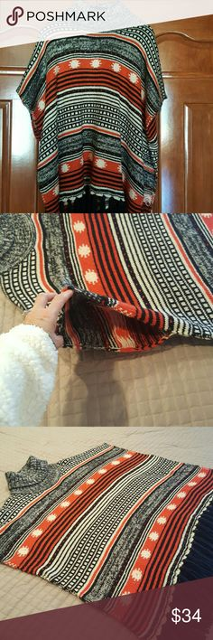 FINAL Reduction, COZY Poncho! Beautiful Poncho is open down the sides with an arm slit(see 2nd photo). Turtle neck with black fringe around the bottom. Size S/M. 100% acrylic.  Worn once. Excellent condition! Super cute with leggings and boots! Tops
