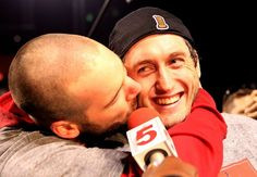Chris Carpenter kisses David Freese as he conducts an interview with the media after the clinching the World Series between the Texas Rangers and St. Louis Cardinals at Busch Stadium on Friday October 28, 2011 in St. Louis.