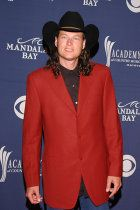 Blake Shelton lets his mullet hang at the Academy of Country Music Awards.