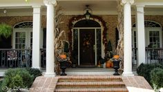 fall-porch-tour: Our Southern Home.  I love this porch!  Wide brick steps, iron railing, wide porch.  Goodness!