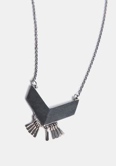 Totally awesome silver-toned necklace featuring a chevron pendant with a matte finish. Complete with metal fringe accents. By The 2 Bandits.