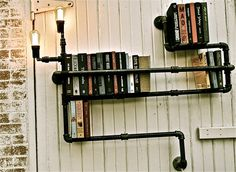 bookshelves made from old pipe