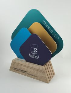 MIXED MATERIALS — ARTISANED AWARDS Wayfinding Signage, Signage Design, Black Wood Stain, Trophies And Medals, Plaque Design, Acrylic Awards, Trophy Design, Custom Awards, Cosmetic Display