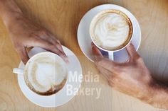 This is a Media Bakery licensable image titled 'Coffee art' by artist PeopleImages.com for editorial and commercial use only. No use with out payment. Search our large selection of royalty free and rights managed stock photos.
