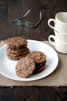 Salted Chocolate Toffee Cookies:  2 cups semisweet chocolate chips  6 Tbsp unsalted butter, sliced  1 cup all-purpose flour*  3/4 tsp baking powder  3/4 tsp kosher salt  3 large eggs  1 cup packed brown sugar  1 tsp vanilla extract  1 cup toffee bits  3/4 cup semisweet chocolate chips
