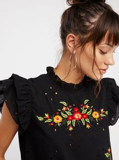 Picnic In The Park Top | Breezy cotton top featuring beautiful floral embroidery, delicate eyelet cutouts and romantic ruffles throughout. * Tie detail in back * Semi-sheer fabrication