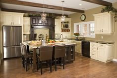 Casey's Creative Kitchens  like the firdge / stove /island with sink triangle