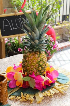 Summer is the time to celebrate with a Luau and decorating for a Luau has never been easier! Fresh fruit Hawaiian leis and tropical leaves come together to create a beautiful centerpiece for your luau table. Make multiple centerpieces in minutes! Aloha Party, Luau Theme Party, Hawaiian Luau Party, Moana Birthday Party, Luau Birthday, Tiki Party, Hawaiian Leis, Birthday Celebration, Moana Party