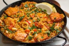Seafood paella, with salmon as the featured ingredient. Reminds me of the paella our friend's mom (who is from Spain) made for us when we were in college.