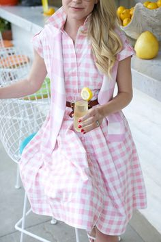 78b88a0865d Blair Eadie wearing a pink gingham dress and pink gingham sweater in Palm  Springs    Click through for more gingham outfit inspiration on  Atlantic-Pacific