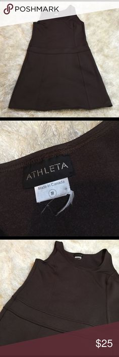 Brown Athleta dress sz M Beautiful dress from Athleta. It's great because it's a little thicker- the inside feels like a soft fleece. Your next favorite piece! Great shape; however on back of dress above waist band the seam is coming out a little. NOT a hole. Easy fix! Chest measures 17.5 inches. Shoulder down 34.5 inches. Waist 17.5. Dress is stretchy. Bundling is fun; check out my other items! No price talk in comments. No trades or holds. Athleta Dresses