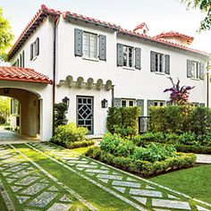 I like the grass driveway with stones. It looks prettier than a traditional concrete driveway, and I guess you don't have to shovel it? Spanish Style Homes, Spanish House, Spanish Revival, Spanish Colonial, Landscape Design, Garden Design, Driveway Design, Driveway Ideas, Stone Driveway