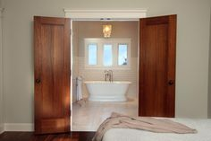 The luxurious soaking tub in the master bathroom beckons like a siren's song.