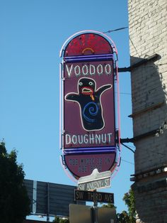 Portland's Voodoo Donut Shop Voodoo Donuts, Donut Signs, Donut Shop, Macabre, Portland, Chains, Places Ive Been, Vacations, Budgeting