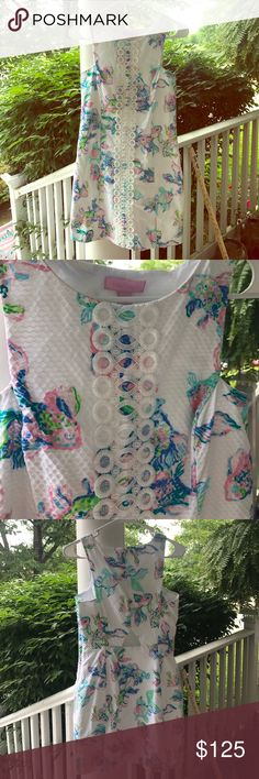 Lilly Pulitzer Cecily Shift White Coastal Kiss 4 Beautiful Shift, one of my favorites. Size 4, worn once. No flaws. Lace up the front is iridescent. Pastel fish pattern with sexy back cut out. Side-zip. Smoke free home Lilly Pulitzer Dresses Mini