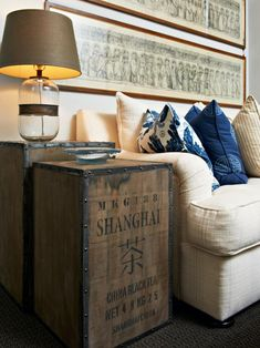 The unexpected use of a shipping crate as a side table gives this neutral living room vintage appeal. The cream sofa and blue throw pillows help pull the look together, making this transitional living room feel sophisticated and collected. Eclectic Living Room, Transitional Living Rooms, Living Spaces, My Home Design, House Design, Best Interior, Interior Design, Living Room End Tables, Dining Rooms