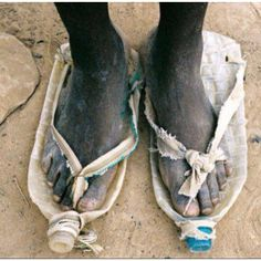 Now this is what I call recycling! pop bottle shoes africa... from desperation comes great inspiration..miyo jergen