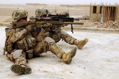 A sniper team scans the area outside of a leaders' shura from a rooftop in the village of Baki Tanna, Spin Boldak district, Kandahar province, Afghanistan. 30 January 2013.