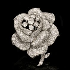 CARTIER.London, circa 1935.Pave set diamond rose clip brooch