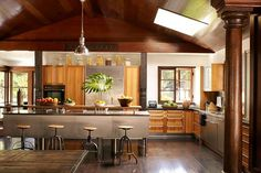 Spacious and bright, earth-toned kitchen in a Bali-inspired retreat.