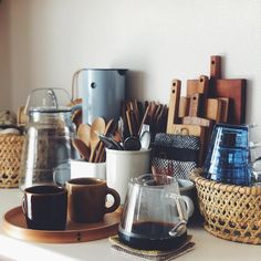 Wooden utensils, rattan baskets, glass pots and ceramic mugs Home Interior, Kitchen Interior, Kitchen Dining, Kitchen Decor, Simple House, Cozy House, Interiores Design, Home Decor Inspiration, Cool Kitchens