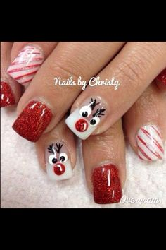 Christmas nails. Reindeer. Red and white. Stripes.