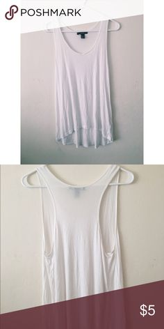 F21 | white sleeveless top F21 oversized white muscle tee. Super versatile. Cute tucked in half way, tied at the waist, or loose for layering. Gently used a couple of times. Forever 21 Tops Muscle Tees