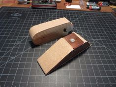 Sanding Blocks by mklotz -- These are two sanding blocks I made just to try out some ideas for anchoring the sandpaper to the block. Both of them employ a wedge arrangement that secures both ends of the paper strip at once. A single screw secures the wedge to the block making paper changes quick and easy. As a modest mathematics exercise both blocks are dimensioned such that a single strip cut from a standard sheet of sandpaper fits exactly without any trimming to length...