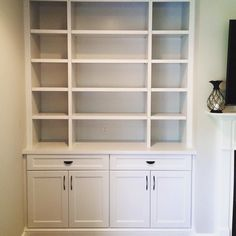 Another side of the built-in shelving made by Woods Cabinets LLC. These are great for books or art pieces, while the closed cabinets and drawers offer plenty of storage. Custom Kitchen Cabinets, Wood Cabinets, Bookshelves, Bookcase, Custom Shelving, Shelving Units, Entertainment Centers, Built Ins, Woods