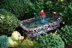 Genius re-purpose & beautiful. Cover old bathtub w/broken tiles & put it in your garden.
