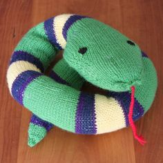Knitted Snake. Free pattern found here: http://www.ravelry.com/patterns/library/striped-snake