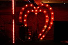 The Double Heart 'Starlet' Arch makes an exciting and Fun Backdrop for the Moulin Rouge Styled Band