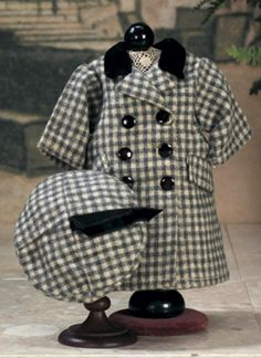 J'aime Ma Bleuette : 96 Depart Lot Number: 96 the costume appeared in the Winter 1954/1955 catalog,comprising woolen coat in grey and cream shadow-pane design,double-breasted front with six black buttons,two pocket flaps,black velvet collar,matching beret with black velvet ribbons