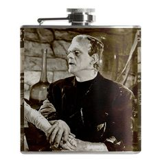 A lovelorn Frankie with the Frankenstein movie poster on the back. Who couldn't use a stiff drink. This 6 ounce flask features a screw down cap and full stainless steel construction with laser welded