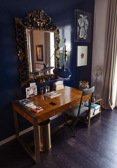Navy laquer is used in this small but elegant home office space.