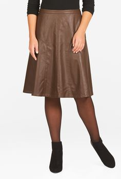 Embrace the 90s fashion revival with our faux leather skirt framed with gracefully curved seams that kicks out from the hip for ease of movement.