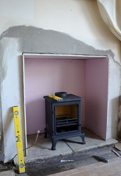 build a hearth for the wood-burning stove (stone and mantel) - now that's a pretty awesome idea Stove Fireplace, Fireplace Wall, Fireplace Surrounds, Wood Stove Surround, Wood Burning Tool, Pellet Stove, Front Rooms, Wood Burner, Into The Woods