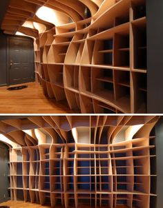 Fluid free-form bookcase by dbd Studio acts as functional storage and sculptural art piece in a Washington, D.C. apartment. MDF is an ideal material for digitally fabricated furniture, which is designed and cut using computer programs.