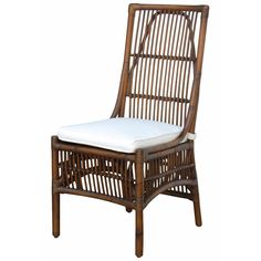 This delightful side chair features a solid rattan construction with a wicker peel and an included white cushion. If you want to bring the casual, relaxed feel of upscale tropical homes right to your living area or sunroom, look no further.