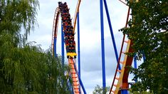 A wide shot of the rollercoaster Behemoth on the backside of an airtime hill at Canada's Wonderland.