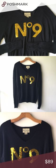 """Wildfox No 9 Sequin V-Neck Sweater White Label Amazing, super soft, warm sweater from Wildfox's White Label line. They make the best sweaters! This one is a dark charcoal gray color, almost black, and emblazoned with gorgeous gold sequin lettering. It says """"No 9,"""" in reference to Love Potion No. 9. Sweater is size S, with the most amazing, slouchy, oversized fit. It is definitely big enough to fit a Sz M as well, but looks so stylishly slouchy on a true small. Perfect condition. 45% viscose…"""