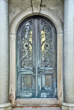 Blue door with Art Nouveau grill work