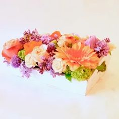 Mid-Range (like the photo)$95.00  A sweet wooden tray filled with spring blooms will be sure to bring a smile!   foxgloves flowers victoria bc florist ambrosia Victoria Bc Canada, Spring Blooms, Image Shows, Floral Wreath, Range, Smile, Sweet, Flowers, Beautiful