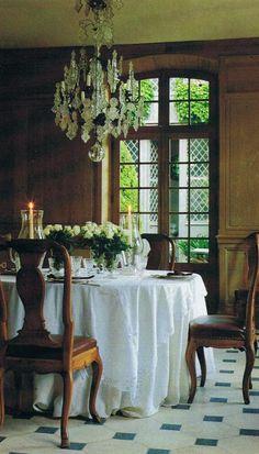 Big window, great floor, woody, greens + chandelier.