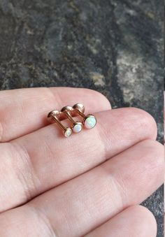 Rose gold Opal  Etsy listing at https://www.etsy.com/listing/249435837/16g-12mm-rose-gold-plated-white-fire