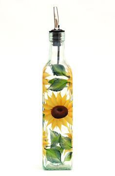 Cheerful yellow sunflower petals with deep brown centers and green leaves hand-painted encircling quality oz bottle. Sealed and heat-cured for added durability. hand-was (Bottle Painting Oil) Glass Bottle Crafts, Bottle Art, Glass Bottles, Beer Bottle, Sunflower Themed Kitchen, Sunflower Kitchen Decor, Painted Wine Bottles, Painted Wine Glasses, Decorated Bottles