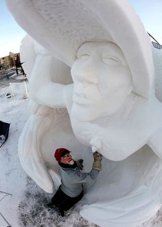 Stunning snow sculptures-Pete Lucchetti builds his snow sculpture named ''Raven Myth'' in the early morning out of a 12-foot-tall, 20-ton block of compacted snow at the outdoor art gallery during the 23rd annual International Snow Sculpture Championships in Breckenridge, Colo., on Jan. 26, 2013