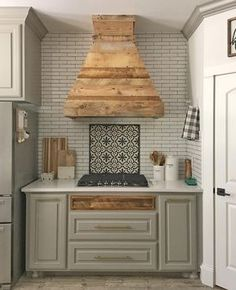 One of my favorite builds yet... ❤️ #shanty2chic #kitchen Free plans coming for the vent hood soon! Cabinet color is Dorian Grey and wall color is Pure White both by Sherwin-Williams! Rest of the goodies are tagged so you can find them...
